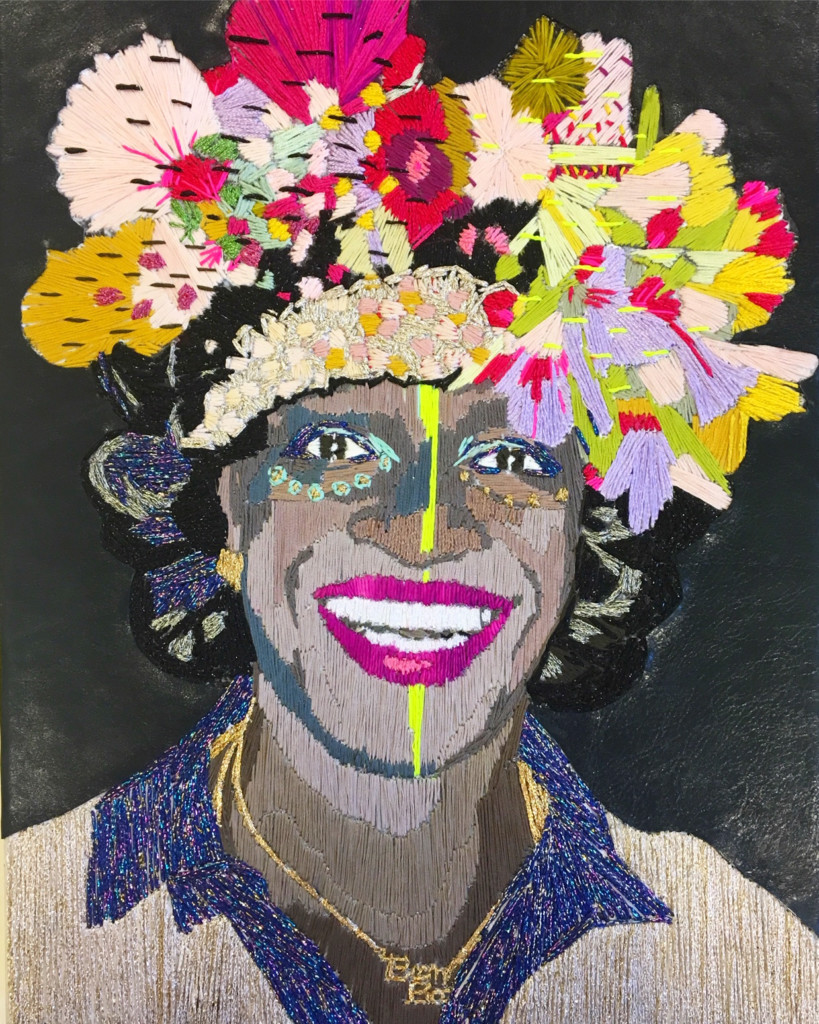 Preta Wolzak is een Nederlandse textielkunstenaar die met behulp van borduren sociaal maatschappelijke kwesties verbeeld. Dit portret is onderdeel van de serie Fighting Females en verbeeld Marsha P. Johnson. Dit werk is te zien in de tentoonstelling Wolzak en Kosters: Serious International Business in Museum Rijswijk | Crafts Council Nederland